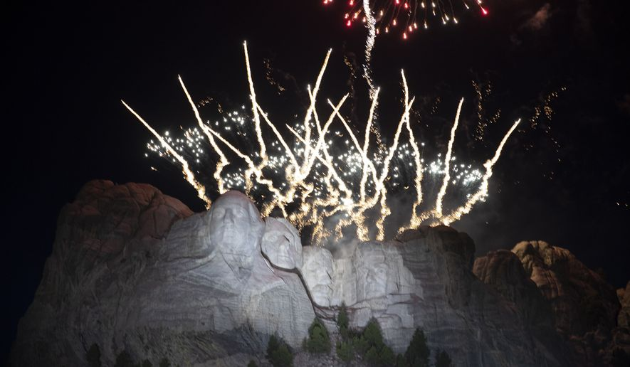 """FILE - In this July 3, 2020, file photo, fireworks light the sky over the Mount Rushmore National Memorial near Keystone, S.D. South Dakota Gov. Kristi Noem indicated Tuesday, June 15, 2021, that she will try again to hold a fireworks display over Mount Rushmore to celebrate Independence Day on the heels of President Joe Biden's announcement that the White House will be hosting its own """"independence from the virus"""" bash.. (AP Photo/Alex Brandon File)"""