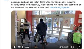 A San Francisco shoplifter takes off on a Lyft bike with a giant bag filled with products during a recent theft. Video of the Monday incident has gone viral on social media. (Image: Twitter, ABC-7 San Francisco, full-tweet screenshot)