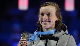 Katie Ledecky reacts during the medal ceremony after winning the women's 400-meter freestyle final during wave 2 of the U.S. Olympic Swim Trials on Monday, June 14, 2021, in Omaha, Neb. (AP Photo/Charlie Neibergall) **FILE**