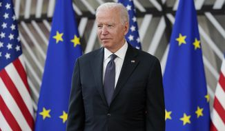 In this June 15, 2021, file photo President Joe Biden arrives for the United States-European Union Summit at the European Council in Brussels. (AP Photo/Patrick Semansky, File)