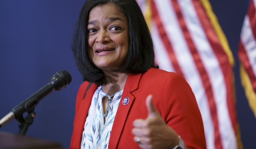 Rep. Pramila Jayapal, D-Wash., chair of the Congressional Progressive Caucus, pauses for reporters after a meeting of the House Democratic Caucus and Biden administration officials to discuss progress on an infrastructure bill, at the Capitol in Washington, Tuesday, June 15, 2021. (AP Photo/J. Scott Applewhite)