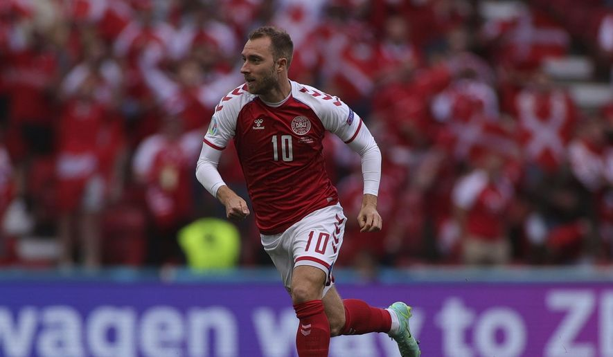 Denmark's Christian Eriksen runs during the Euro 2020 soccer championship group B match between Denmark and Finland at Parken stadium in Copenhagen, Denmark, Saturday, June 12, 2021. Eriksen collapsed on the pitch and received medical assistance before being taken to hospital. (Wolfgang Rattay/Pool via AP) **FILE**