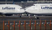In this Feb.14, 2019, file photo, an Airbus A380, left, and a Boeing 747, both from Lufthansa airline pass each other at the airport in Frankfurt, Germany. The United States and the European Union on Tuesday appeared close to clinching a deal to end a damaging dispute over subsidies to Airbus and Boeing and lift billions of dollars in punitive tariffs. (AP Photo/Michael Probst, File)