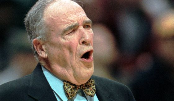 Mount St. Mary's coach Jim Phelan yells to his players in a first-round game of the NCAA Midwest Regional against Michigan State, Friday, March 12, 1999, at the Bradley Center in Milwaukee. (AP Photo/Jeffrey Phelps) **FILE**