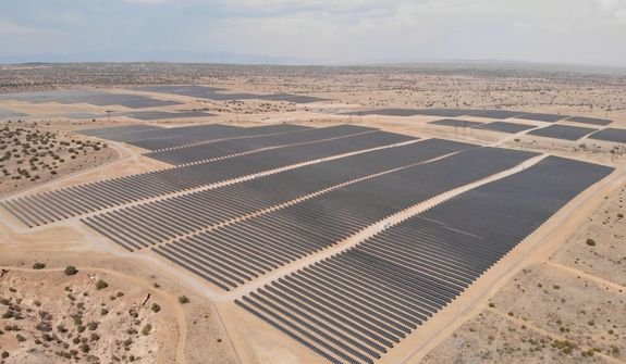 This Tuesday, June 15, 2021 image shows a solar farm west of Rio Rancho, N.M., that Public Service Co. of New Mexico uses to help power Facebook's data center in central New Mexico. The utility has received dozens of pre-applications and interconnection requests as state regulators draft new rules for community solar programs. (AP Photo/Susan Montoya Bryan)
