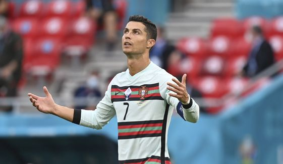 Portugal's Cristiano Ronaldo reacts during the Euro 2020 soccer championship group F match between Hungary and Portugal at the Ferenc Puskas stadium in Budapest, Hungary, Tuesday, June 15, 2021. (Tibor Illyes/Pool via AP)