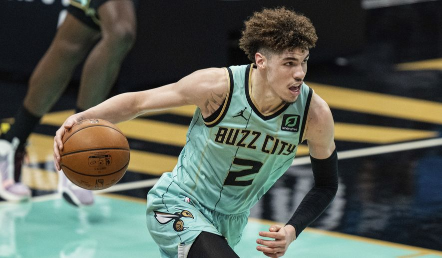 In this May 13, 2021, file photo, Charlotte Hornets guard LaMelo Ball brings the ball up against the Los Angeles Clippers during an NBA basketball game in Charlotte, N.C. Ball's versatility as a passer, scorer and rebounder earned him NBA Rookie of the Year honors Wednesday, June 16, despite his missing 21 games with a fractured wrist. Ball beat out finalists Anthony Edwards from the Minnesota Timberwolves and Tyrese Haliburton from the Sacramento Kings to win the award, which was determined by a global panel of 100 writers and broadcasters who cover the league. (AP Photo/Jacob Kupferman, File) **FILE**
