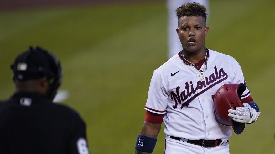 In this Monday, June 14, 2021, photo, Washington Nationals second baseman Starlin Castro (13) talks to the umpire during a baseball game, in Washington. The Washington Nationals announced Wednesday, June 16, 2021, that Castro has been placed on the Restricted List. (AP Photo/Carolyn Kaster) **FILE**
