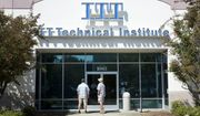 Students find the doors locked to the ITT Technical Institute campus in Rancho Cordova, Calif. The U.S. Education Department says it's erasing student debt for thousands of borrowers who attended a for-profit college chain that made exaggerated claims about its graduates' success in finding jobs. The Biden administration is approving 18,000 loan forgiveness claims from former students of ITT Technical Institute, a chain that closed in 2016. (AP Photo/Rich Pedroncelli, File)