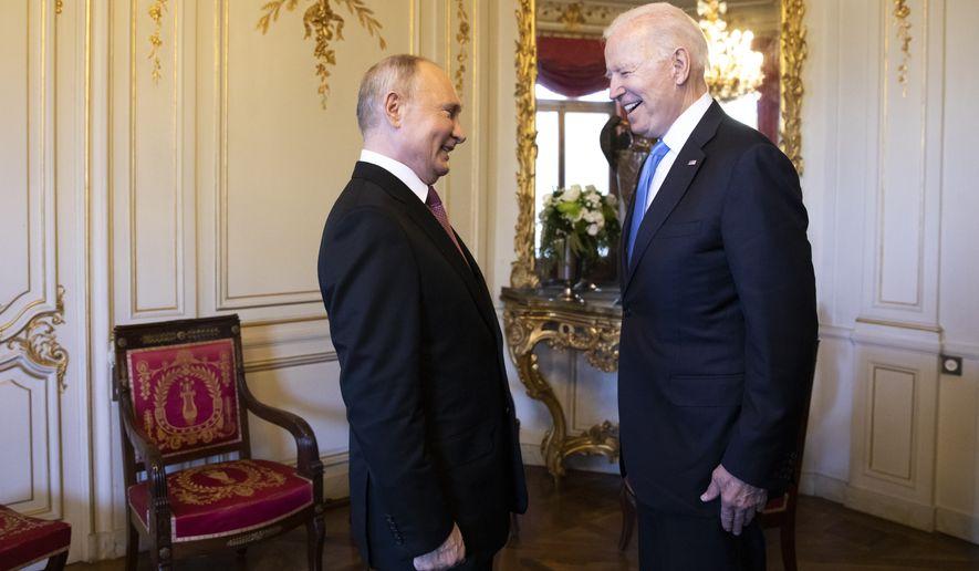 Russian president Vladimir Putin, left, talks with US president Joe Biden, right, during the US - Russia summit in Geneva, Switzerland, Wednesday, June 16, 2021. (Peter Klaunzer/Keystone via AP)
