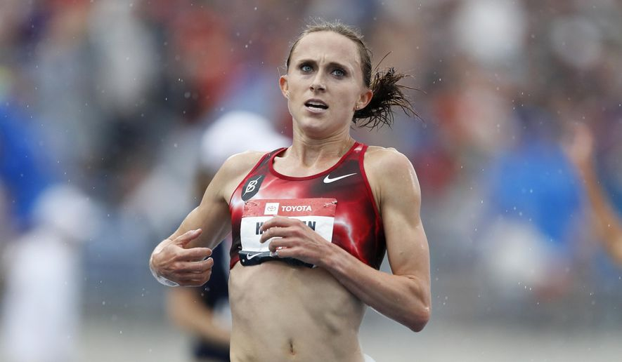 In this Sunday, July 28, 2019, file photo, Shelby Houlihan crosses the finish line as she wins the women's 5,000-meter run at the U.S. Championships athletics meet, in Des Moines, Iowa. Houlihan, the American record holder in the 1,500 and 5,000 meters, posted on social media that she's been banned for four years following a positive test for what she concluded was a tainted pork burrito. Houlihan said she received an email from the Athletics Integrity Unit (AIU) on Jan. 14, 2021, notifying her that a drug testing sample returned a finding for the anabolic steroid nandrolone. (AP Photo/Charlie Neibergall, File) **FILE**