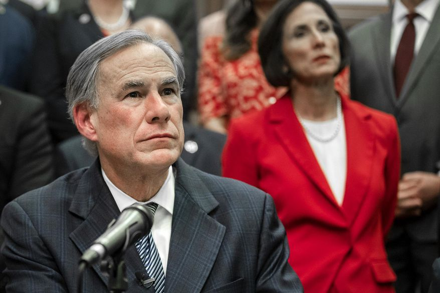 """Gov. Greg Abbott speaks during a press conference on details of his plan for Texas to build a border wall and provide $250 million in state funds as a """"down payment."""", Wednesday, June 16, 2021, in Austin, Texas. (Ricardo B. Brazziell/Austin American-Statesman via AP) ** FILE **"""