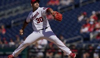 Washington Nationals relief pitcher Paolo Espino delivers a pitch during the first inning of a baseball game against the Pittsburgh Pirates, Wednesday, June 16, 2021, in Washington. (AP Photo/Carolyn Kaster)