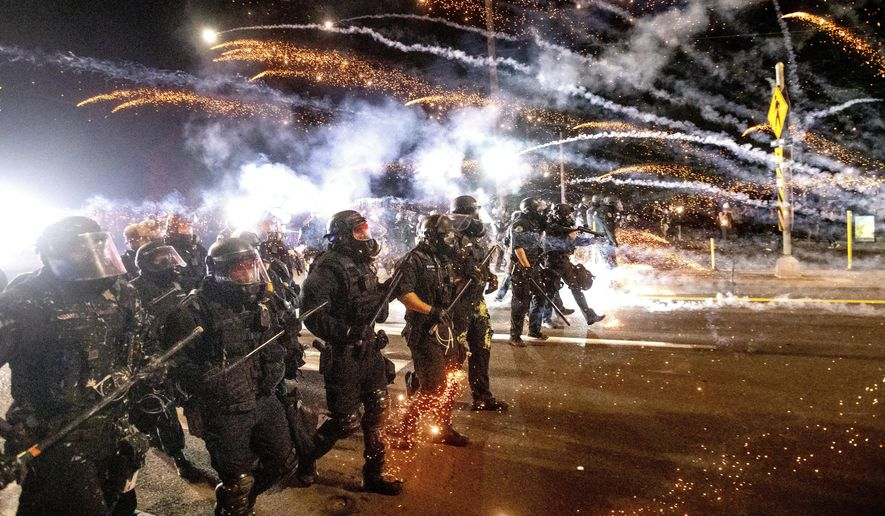 Police use chemical irritants and crowd control munitions to disperse protesters during a demonstration in Portland, Oregon, Sept. 5, 2020. (AP Photo/Noah Berger) **FILE**