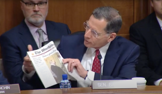 """Sen. John Barrasso, Wyoming Republican, reads from Thursday's front-page article in The Washington Times, """"Tree spiking case haunts nominee for public lands."""" (Screengrab via https://www.youtube.com/watch?v=69lPYIUE9_E)"""