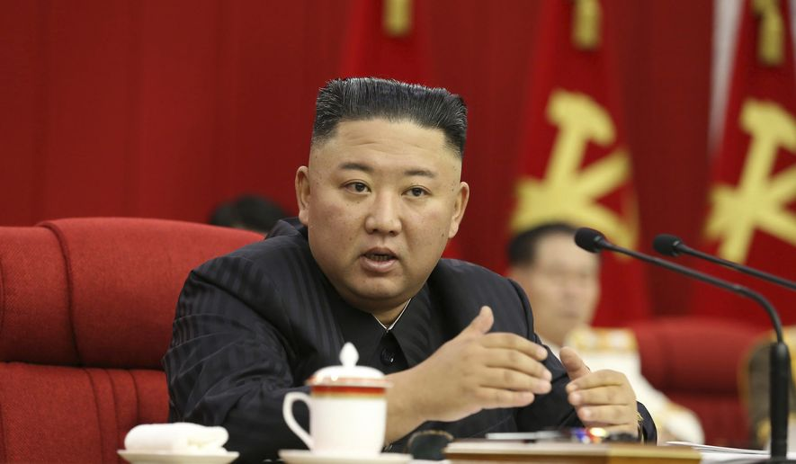 In this photo provided by the North Korean government, North Korean leader Kim Jong-un speaks during a Workers' Party meeting in Pyongyang, North Korea, Thursday, June 17, 2021. Kim ordered his government to be fully prepared for confrontation with the Biden administration, state media reported Friday, June 18, days after the United States and other major powers urged the North to abandon its nuclear program and return to talks. Independent journalists were not given access to cover the event depicted in this image distributed by the North Korean government. The content of this image is as provided and cannot be independently verified. (Korean Central News Agency/Korea News Service via AP)