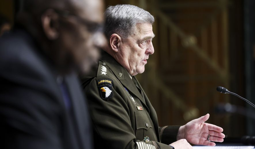 Secretary of Defense Lloyd Austin, left, and Chairman of the Joint Chiefs Chairman Gen. Mark Milley testify before a Senate Appropriations Committee hearing, Thursday, June 17, 2021, on Capitol Hill in Washington. (Evelyn Hockstein/Pool via AP)