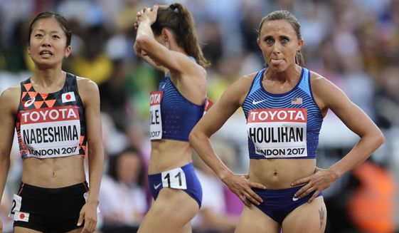 United States' Shelby Houlihan, right, reacts after finishing a women's 5000m heat during the World Athletics Championships in London, in this Thursday, Aug. 10, 2017, file photo. Banned runner Shelby Houlihan is in the lineup and will be allowed to run at U.S. Olympic track trials while any appeals she files are pending. The American record holder at 1,500 and 5,000 meters, Houlihan is on the start list for Fridays, June 18, 2021, 5,000 preliminaries. (AP Photo/Tim Ireland, File) **FILE**