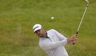 Matthew Wolff plays a shot from a bunker on the 11th hole during the first round of the U.S. Open Golf Championship, Thursday, June 17, 2021, at Torrey Pines Golf Course in San Diego. (AP Photo/Marcio Jose Sanchez)