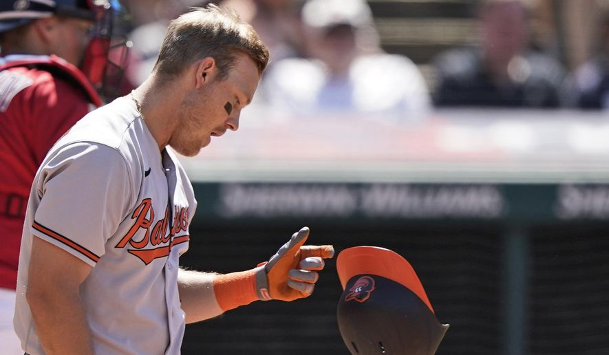 Baltimore Orioles' Pat Valaika drops his helmet after striking out in the eighth inning of a baseball game against the Cleveland Indians, Thursday, June 17, 2021, in Cleveland. (AP Photo/Tony Dejak)