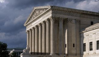 In this June 8, 2021, photo, the Supreme Court is seen in Washington. (AP Photo/J. Scott Applewhite)