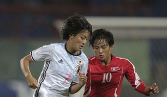 North Korea's KO Koyng Hui, right, fights for the ball against Japan's Saori Takarada during the FIFA U-17 women's World Cup final match in Amman Friday, Oct. 21, 2016. North Korea defeated Japan 5:4 in a penalty shootout and became champion. (AP Photo/Raad Adayleh) **FILE**
