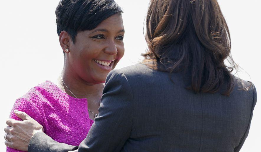 Vice President Kamala Harris is greeted by Atlanta Mayor Keisha Lance Bottoms as she arrives Friday, June 18, 2021, in Atlanta. (AP Photo/Jacquelyn Martin)