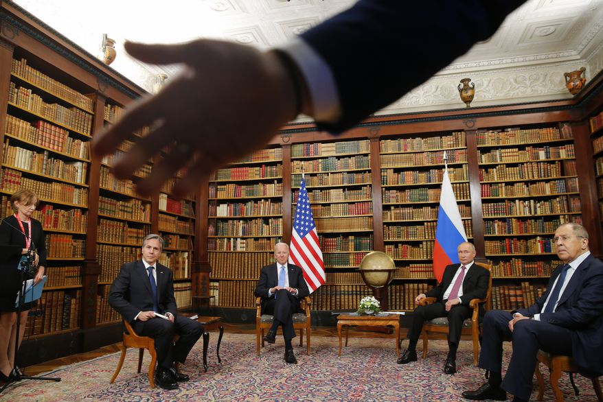 A security officer indicates to the media to step back as U.S. President Joe Biden, second from left, U.S. Secretary of State Antony Blinken, left, Russia's President Vladimir Putin, second from right, and Russia's Foreign Minister Sergei Lavrov, right, meet for the U.S.-Russia summit at Villa La Grange in Geneva, Switzerland, Wednesday, June 16, 2021. (Denis Balibouse/Pool Photo via AP)