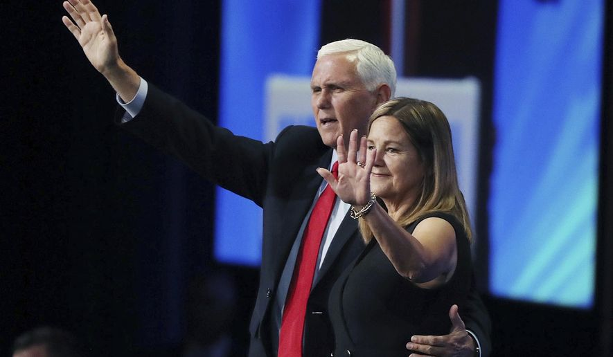 Former vice president Mike Pence and his wife Karen wave after he spoke during the Road to Majority convention at Gaylord Palms Resort & Convention Center in Kissimmee, Fla., on Friday, June 18, 2021. (Stephen M. Dowell/Orlando Sentinel via AP)