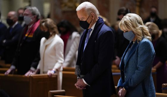 In this Wednesday, Jan. 20, 2021 file photo, President-elect Joe Biden and his wife, Jill Biden, attend Mass at the Cathedral of St. Matthew the Apostle during Inauguration Day ceremonies in Washington. The U.S. Conference of Catholic Bishops will draft a document setting forth the American church's position on the Eucharist — possibly including instructions on who should, and should not, receive the sacrament, such as President Biden, a Catholic who has expanded abortion funding during his first months in office. (AP Photo/Evan Vucci, File)  **FILE**