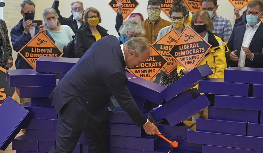 Liberal Democrat leader Ed Davey during a victory rally at Chesham Youth Centre in Chesham, England, Friday June 18, 2021, after Sarah Green won the Chesham and Amersham by-election. In a surprising result, Prime Minister Boris Johnson's Conservative Party was easily defeated in a special election for a seat it has held onto for decades. (Steve Parsons/PA via AP)