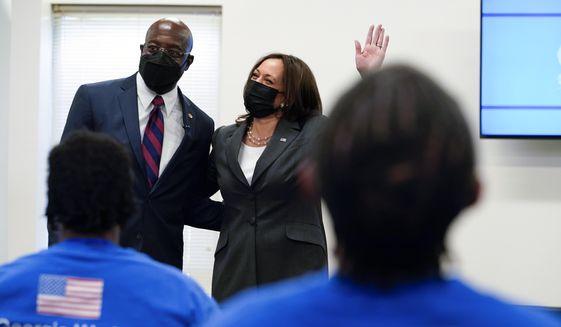 Vice President Kamala Harris stands with Sen. Raphael Warnock, D-Ga., as she speaks at a COVID-19 vaccine pop-up center at Ebenezer Baptist Church, Friday, June 18, 2021, in Atlanta. (AP Photo/Jacquelyn Martin)