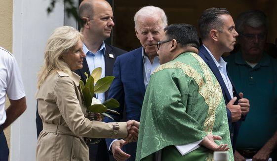 President Joe Biden and first lady Jill Biden speak with a priest as he departs after Mass at St. Joseph on the Brandywine Catholic Church, Saturday, June 19, 2021, in Wilmington, Del. (AP Photo/Alex Brandon)