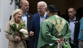 President Joe Biden and first lady Jill Biden speak with a priest as they depart after Mass at St. Joseph on the Brandywine Catholic Church, Saturday, June 19, 2021, in Wilmington, Del. (AP Photo/Alex Brandon)