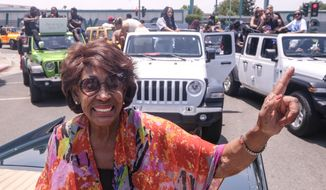 Congresswoman Maxine Waters waves in her car during a car parade to mark Juneteenth on Saturday, June 19, 2021, in Inglewood, Calif. (AP Photo/Ringo H.W. Chiu)