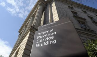 In this photo March 22, 2013, file photo, the exterior of the Internal Revenue Service (IRS) building in Washington. (AP Photo/Susan Walsh, File)  **FILE**
