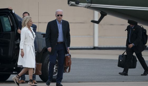 President Joe Biden and first lady Jill Biden walk to depart on Marine One from Delaware Air National Guard Base, Sunday, June 20, 2021, in New Castle, Del. (AP Photo/Alex Brandon)