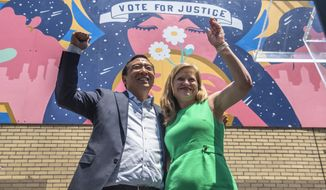 """Mayoral candidates Andrew Yang and Kathryn Garcia wave to New Yorkers after speaking at the AAPI Democracy Project's """"Voting is Justice Rally"""" in Chinatown on Sunday, June 20, 2021, in New York. (AP Photo/Brittainy Newman)"""