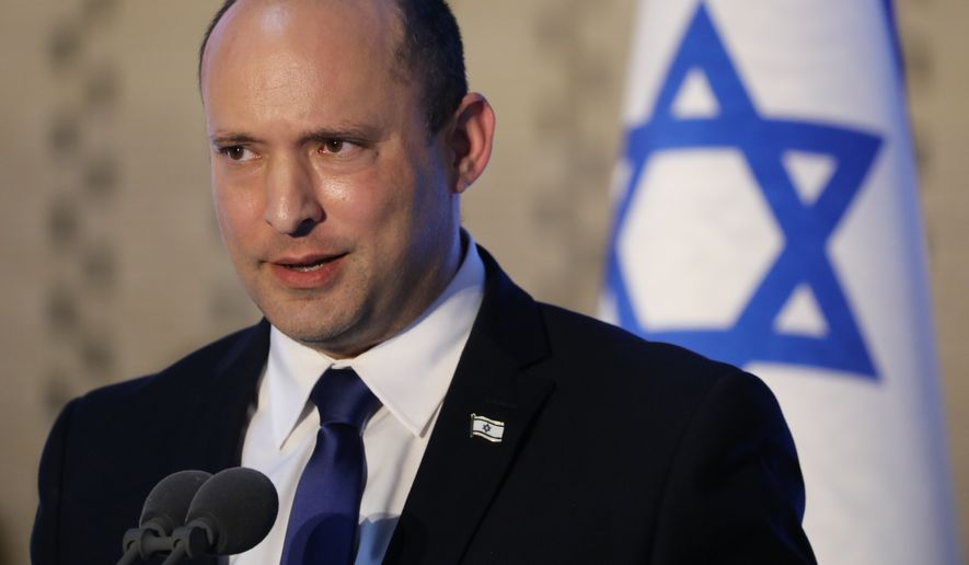 Israeli Prime Minister Naftali Bennett, speaks during a memorial ceremony for Israeli soldiers who fell in battle during the 2014 Gaza War, in the Hall of Remembrance at Mount Herzl Military Cemetery in Jerusalem, Israel, Sunday, June 20, 2021. (Abir Sultan/Pool Photo via AP)