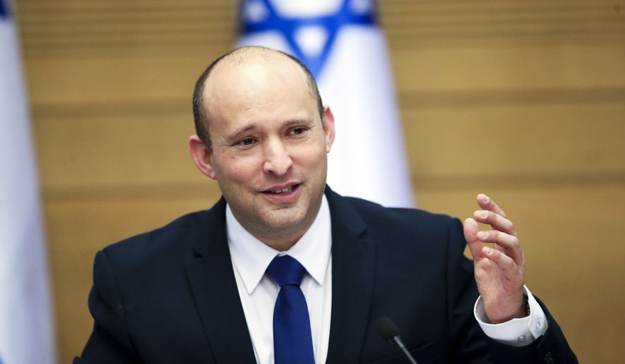 In this June 13, 2021, file photo Israel's new prime minister, Naftali Bennett, holds a first Cabinet meeting in Jerusalem. How President Joe Biden and Bennett manage that relationship will shape the prospects for peace and stability in the Middle East. They are ushering in an era no longer shaped by the powerful personality of Prime Minister Benjamin Netanyahu, who repeatedly defied the Obama administration, and then reaped the rewards of a warm relationship with President Donald Trump. (AP Photo/Ariel Schalit, File)