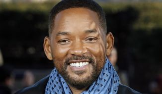 """Will Smith poses for photographers during the photo call of """"Bad Boys for Life,"""" in Paris. (AP Photo/Thibault Camus, File)"""