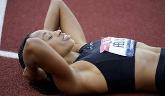 Allyson Felix reacts to her second place in the women's 400-meter run at the U.S. Olympic Track and Field Trials Sunday, June 20, 2021, in Eugene, Ore. (AP Photo/Ashley Landis)