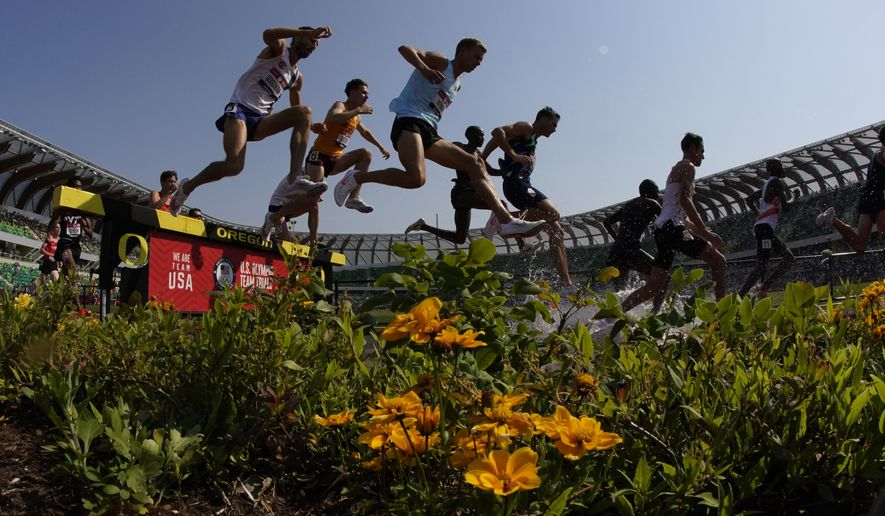 Runners compete during the first heat of the men's 3000-meter steeplechase at the U.S. Olympic Track and Field Trials Monday, June 21, 2021, in Eugene, Ore. (AP Photo/Charlie Riedel) **FILE**