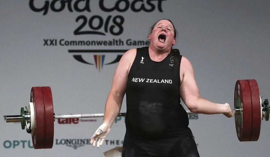 In this April 9, 2018 photo, New Zealand's Laurel Hubbard reacts after failing to make a lift in the snatch of the women's +90kg weightlifting final at the 2018 Commonwealth Games on the Gold Coast, Australia.Hubbard will be the first transgender athlete to compete at the Olympics.Hubbard is among five athletes confirmed on New Zealand's weightlifting team for the Tokyo Games. (AP Photo/Manish Swarup, File)
