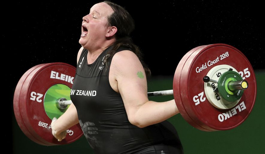In this April 9, 2018, photo, New Zealand's Laurel Hubbard reacts after failing to lift in the snatch of the women's +90kg weightlifting final at the 2018 Commonwealth Games on the Gold Coast, Australia. Hubbard will be the first transgender athlete to compete at the Olympics. Hubbard is among five athletes confirmed on New Zealand's weightlifting team for the Tokyo Games. (AP Photo/Mark Schiefelbein) **FILE**