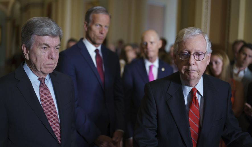 Sen. Roy Blunt, R-Mo., left, Senate Minority Leader Mitch McConnell, R-Ky., right, and the Republican leadership talk to reporters about progress on an infrastructure bill and voting rights legislation, at the Capitol in Washington, Tuesday, June 15, 2021. (AP Photo/J. Scott Applewhite)
