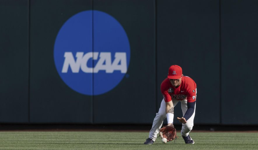 Arizona's Ryan Holgate fields a hit by Vanderbilt's Dominic Keegan during the first inning of a baseball game in the NCAA College World Series on Saturday, June 19, 2021, in Omaha, Neb. (AP Photo/Rebecca S. Gratz) **FILE**