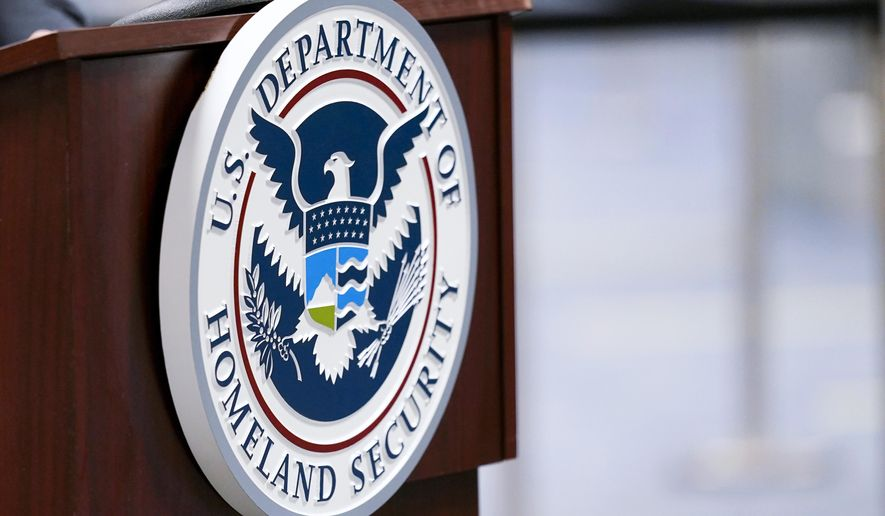 In this Nov. 20, 2020, file photo, a U.S. Department of Homeland Security plaque is displayed at a podium as international passengers arrive at Miami International Airport where they are screened by U.S. Customs and Border Protection in Miami. (AP Photo/Lynne Sladky) ** FILE **