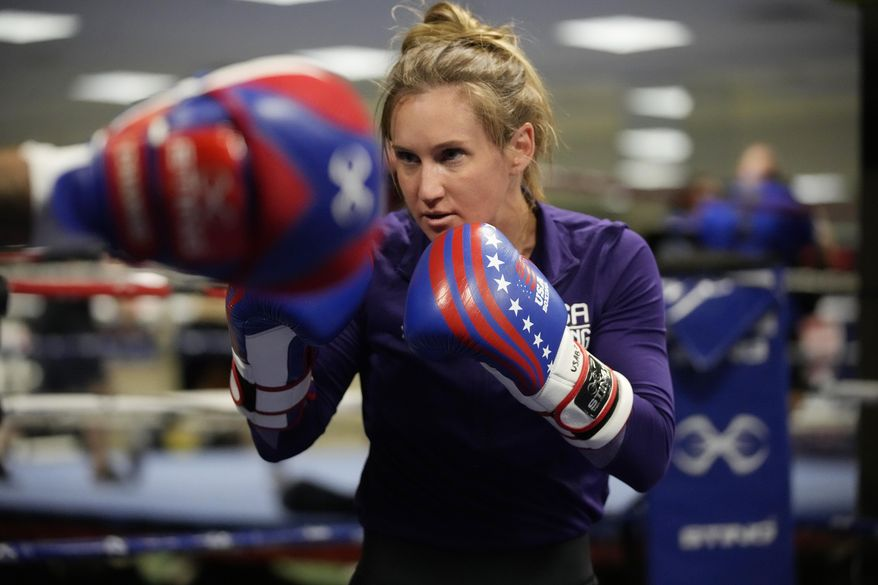 USA Boxing team member Ginny Fuchs takes part in drills during media day for the team in a gym located in a converted Macy's Department store in Colorado Springs, Colo., in this Monday, June 7, 2021, file photo. Fuchs' obsessive-compulsive disorder sometimes compels her to use a dozen toothbrushes a night and to buy hundreds of dollars of cleaning products per week. Yet Fuchs is headed to Tokyo next week to compete in the Olympic boxing tournament, where she realizes it's almost impossible to avoid touching the blood, sweat and spit of her opponents.(AP Photo/David Zalubowski, File) **FILE**