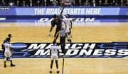 In this March 19, 2019, file photo, Fairleigh Dickinson's Kaleb Bishop (12) and Prairie View A&M's Iwin Ellis (13) leap for the opening tip-off in the first half of a First Four game of the NCAA college basketball tournament in Dayton, Ohio. NCAA President Mark Emmert told the organization's more than 1,200 member schools Friday, June 18, 2021, that he will seek temporary rules as early as July to ensure all athletes can be compensated for their celebrity with a host of state laws looming and congressional efforts seemingly stalled. (AP Photo/John Minchillo, File)